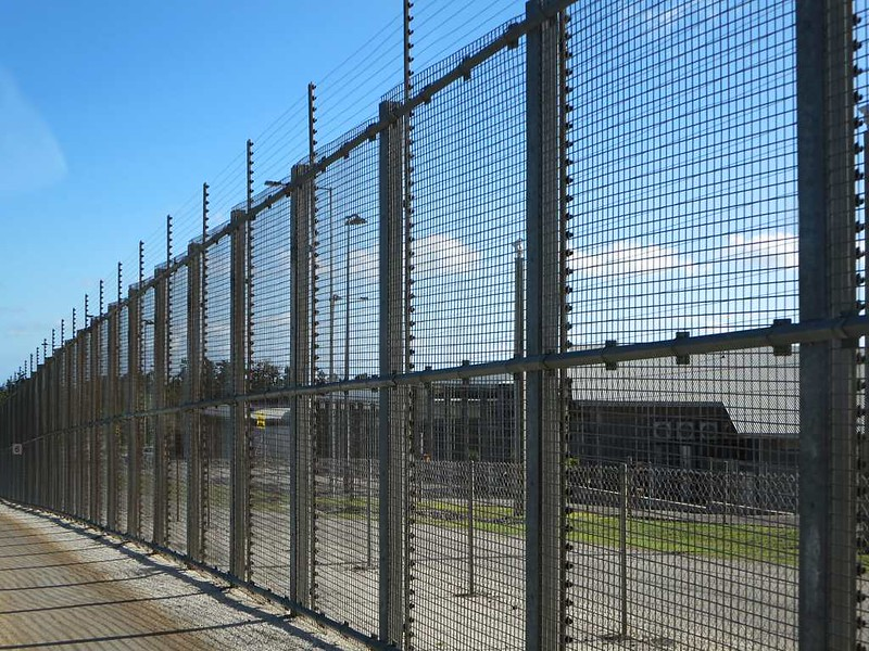 Photography of the border fence at Christmas Island Detention Centre.